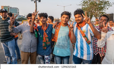 Mumbai ,26,April,2019 : Group of  supporters of Prime Minister, Narendra Modi ,BJP showing victory sign in public meeting for 2019 election  at Bandra Kurla Complex ,Mumbai ,Maharashtra ,India, Asia