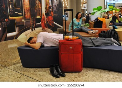 MUMBAI - APR 14: Travellers rest in the transit lounge at the new terminal T2 of Chhatrapati Shivaji International Airport on Apr 14, 2014 in Mumbai, India. The airport first opened in 1942.