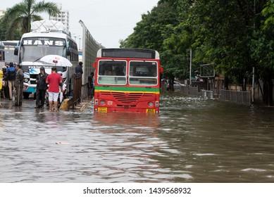 Mumbai / India 01 July 2019 A passenger bus moves through a water-logged road during rains at Mumbai Maharashtra India