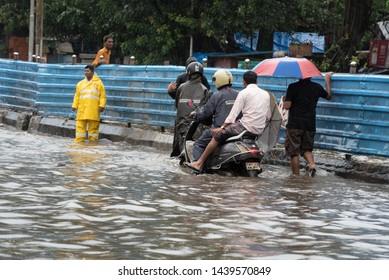 Mumbai / India 01 July 2019 People wade through water-logged streets after Mumbai continues to be lashed by heavy rain in Maharashtra India
