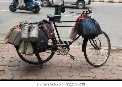 Mumbai / India 08 June 2018 Dabbawalas load tiffin boxes onto their bicycles before delivering them to offices  in Mumbai Maharashtra India
