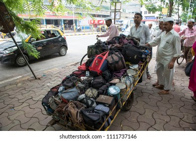 Mumbai / India 08 June 2018 Dabbawalas push their cart with lunchboxes through the streets of Mumba in Maharashtra India
