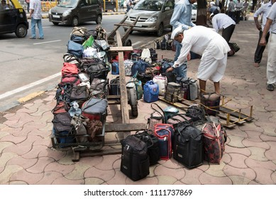 Mumbai / India 08 June 2018 Tiffinwala or dabbawala arranging lunchboxes in crate  in Mumbai Maharashtra India