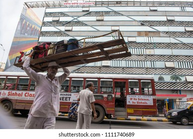 Mumbai / India 08 June 2018  Dabbawala carrying lunchboxes on head at Churchgate  in Mumbai Maharashtra India