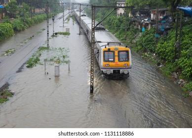 Mumbai / India 09 July 2018 Local trains stranded as railway tracks vanishes under the flooded water caused by heavy rain in Mumbai Maharashtra India