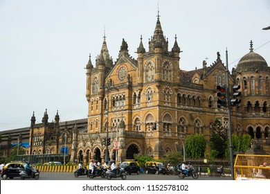 MUMBAI, INDIA, 1 AUGUST 2018 : Busy traffic in front of Chhatrapati Shivaji Terminus or Victoria Terminus, It is UNESCO World Heritage Site and an historic railway station in Mumbai.