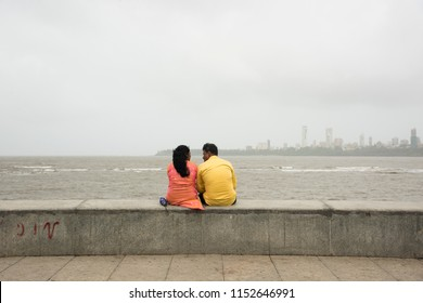 MUMBAI, INDIA, 1 AUGUST 2018 : Unidentified people and tourist on Marine Drive, Marine Drive is a 3 kilometer long boulevard in South Mumbai, It is a road along the coast.