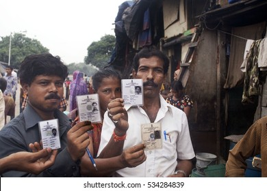 mumbai / India 1 January 2000  Mumbai voters  displays his voter identity card after casting his vote at Mumbai Maharashtra India