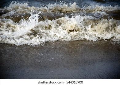 Mumbai / India 1 July 2012   Mumbai ,Wave Crashing On Beach at Girgaon Chowpatty Mumbai   Maharashtra , India