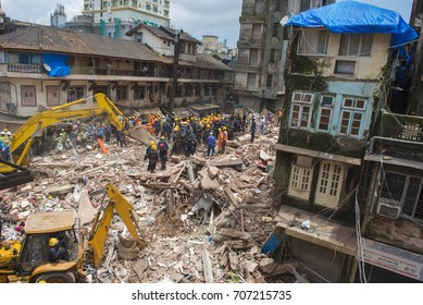 Mumbai / India 1 September 2017 Rescue operations at the site of a building collapse in the Bhendi Bazaar area of south Mumbai in Maharashtra  India