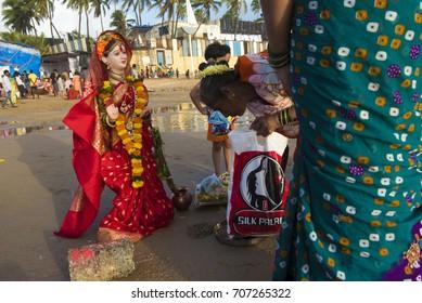 Mumbai / India 1 September 2017 Hindu devotees perform prayer before immersing idols of goddess gauri  the mother of Hindu God  ganesha at juhu beach in Mumbai Maharashtra  India