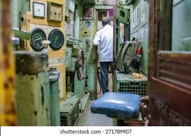 MUMBAI, INDIA - 10 JANUARY 2015: Indian train driver on Chhatrapati Shivaji Terminus.