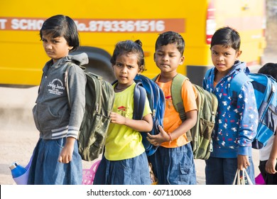 MUMBAI, INDIA 11 FEBRUARY 2017 : unidentified small happy school kids coming from home to school by school bus.