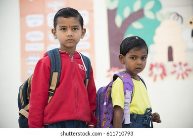 MUMBAI, INDIA 11 FEBRUARY 2017 : Unidentified small happy school kids coming from home with bags to school early in the morning.