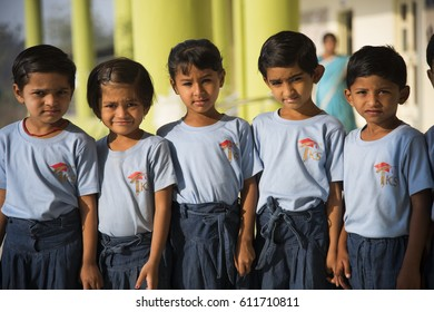 MUMBAI, INDIA 11 FEBRUARY 2017 : Unidentified small happy school kids coming from home to school early in the morning.