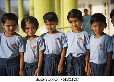 MUMBAI, INDIA 11 FEBRUARY 2017 : Unidentified small happy school kids in front of their school.