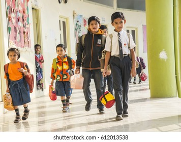 MUMBAI, INDIA 11 FEBRUARY 2017 : Unidentified group of small happy school kids walking in school corridor.