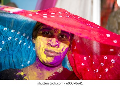 Mumbai / India 13 March 2017 An Indian woman's face is smeared with colored powder during celebrations of the Holi festival. at malad Mumbai Maharashtra India