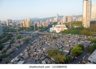 Mumbai / India 13 May 2018 Contrast of modern highrise rich buildings and poor slums at Goregaon in Mumbai Maharashtra India