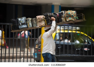Mumbai / India 14 June 2018 Tiffinwala or dabbawala carrying lunchboxes in crate  at Churchgate railway station in Mumbai Maharashtra India