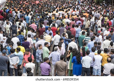 Mumbai / India 15 August 2014  Crowded on road  people gathered to see dahi handi on Govinda Gokul ashtami festival  in Mumbai Maharashtra India