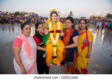 Mumbai / India 17 September 2018 Devotees carry a statue of the Hindu goddess Gauri ( mother of ganesha) to be immersed into the Arabian Sea on the fifth day at Juhu beach Mumbai India