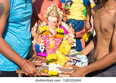 Mumbai / India 17 September 2018 Devotees carry a statue of the Hindu god Ganesh the deity of prosperity to be immersed into the Arabian Sea on the fifth day at Juhu beach Mumbai India