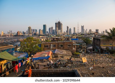 Mumbai / India 18 February 2018 Hutments at Worli village and background city skyline in Bombay Mumbai Maharashtra  India