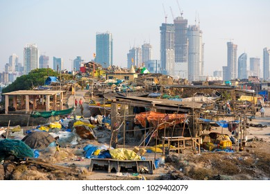 Mumbai / India 18 February 2018 Hutments at Worli village and background city skyline in Bombay Mumbai Maharashtra  India