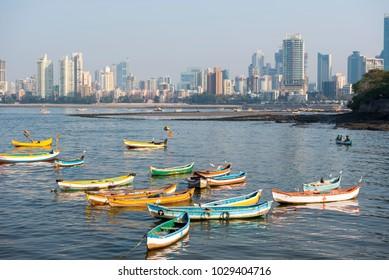 Mumbai / India 18 February 2018  Fishing boat and Mumbai Skyline at traditional fishing village of Worli  in Bombay Mumbai Maharashtra  India