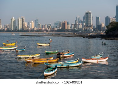 Mumbai / India 18 February 2018  Fishing boat and Mumbai Skyline at traditional fishing village of Worli  in Bombay Mumbai Maharashtra  India