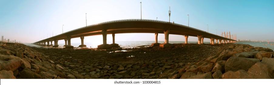 Mumbai / India 18 February 2018 Panoramic view of Bandra Worli Sea Link Bridge or Rajiv Gandhi Sea link at sunset from Worli village in Bombay Mumbai Maharashtra  India