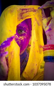 Mumbai / India 2  March 2018 Portrait of an Indian woman face is smeared with colored powder during Holi festival only one eye visible  in Bombay Mumbai Maharashtra  India