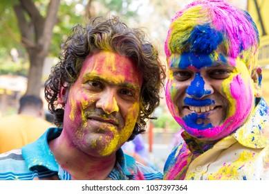 Mumbai / India 2  March 2018 Close up portraits of Indian young men with Holi colors on face  in Bombay Mumbai Maharashtra  India
