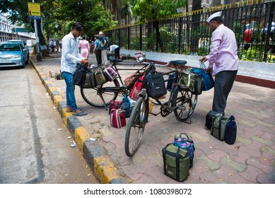 Mumbai / India 20 April 2018 Dabbawalas loading tiffin boxes onto bicycles for delivery throughout Mumbai At Churchgate Railway in Mumbai  Maharashtra
