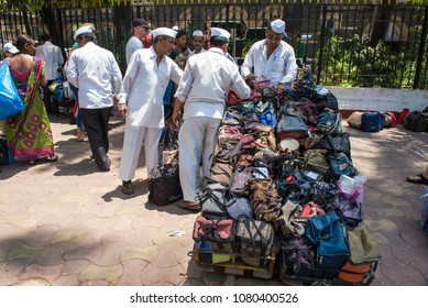 Mumbai / India 20 April 2018 Dabbawalla loading lunch containers on a carts At Churchgate Railway in Mumbai  Maharashtra