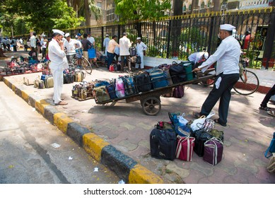 Mumbai / India 20 April 2018 Dabbawala arranging lunchboxes in crate At Churchgate Railway in Mumbai  Maharashtra