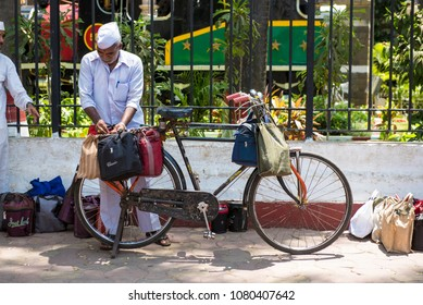 Mumbai / India 20 April 2018 Dabbawalas carrying lunchbox on cycle At Churchgate Railway in Mumbai  Maharashtra