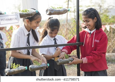 MUMBAI, INDIA 20 FEBRUARY 2017 : Unidentified happy school Children working in garden at their school.