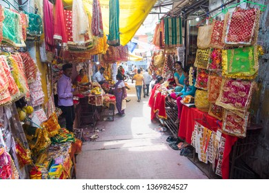 MUMBAI, INDIA, 21 OCTOBER 2015 : Unidentified street vendor  selling various good on their street shop for diwali festival, An Indian scene.