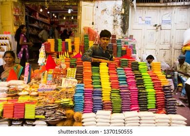 MUMBAI, INDIA, 21 OCTOBER 2015 : Street vendor selling Decorative Items rangoli colors on street side shops on the occasion of Diwali festival at market.