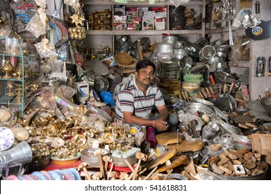 MUMBAI, INDIA, 21 OCTOBER 2015 : unidentified store owner selling various kitchen pottery and other products made from metal are common on Asian markets.