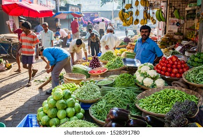 Mumbai, India - 2/2/2011:  An Indian man is  selling fruit and vegetables at a street market in Mumbai, India