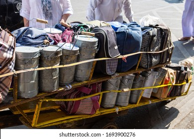 Mumbai, India, 25 november, 2019 / Dabbawala lunchbox or tiffin box service in Mumbai, Churchgate Station: metallic and textile containers with hand written area codes ready to be delivered.