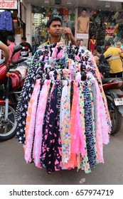 Mumbai, India - 25 October 2016: An unidentified vendor selling  scarves in the Dadar market.