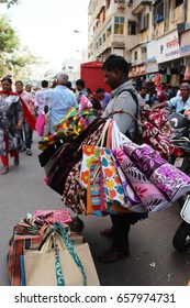 Mumbai, India - 25 October 2016: An unidentified vendor selling handbags in the Dadar market.