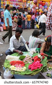 Mumbai, India - 25 October 2016: An unidentified vendor selling  flowers in the Dadar market during the onset of Diwali in 2016.
