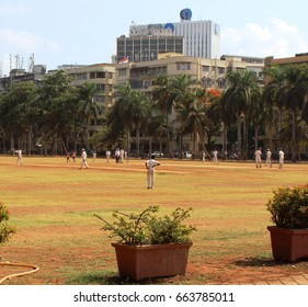 Mumbai, India - 27 May, 2017: An on-going cricket match at Azad Maidan. Azad Maidan is a regular venue for inter-school cricket matches in Mumbai.