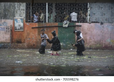 Mumbai / India 29 August 2017 People walks through the water during heavy rain in Mumbai at Dadar railway station Mumbai Maharashtra  India