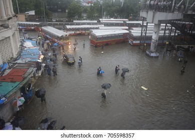 Mumbai / India 29 August 2017 People walks through the water during heavy rain in Mumbai at Bandra  bus stand  Mumbai Maharashtra  India